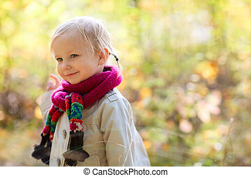 Toddler girl outdoors at autumn day - Adorable toddler girl...