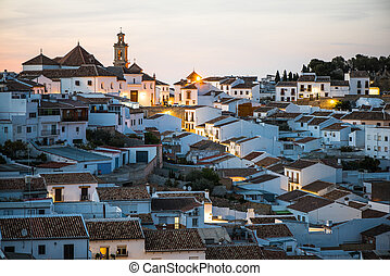 Rooftops and illuminated cityscape of Antequera,Spain