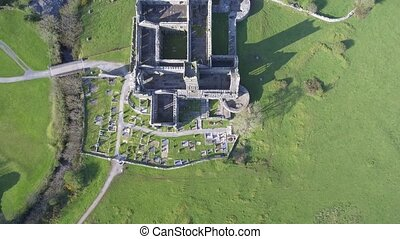 Aerial view of an Irish public free tourist landmark, Quin Abbey, County clare, Ireland. Aerial landscape view of this beautiful ancient celtic historical architecture in county clare ireland.