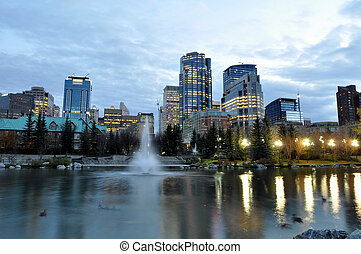 Calgary skyline - Skyscrapers tower over urban park in...