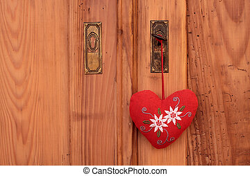 Rural decoration with stuffed heart in front of wooden...