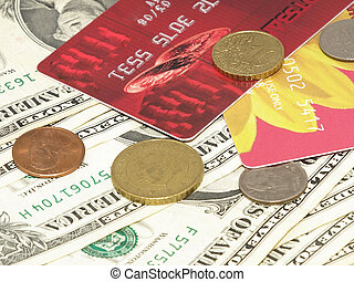 Bank card. - Bank card, dollar bills and different coins.