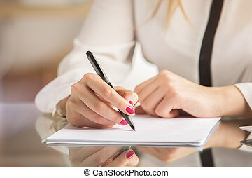 Female doing paperwork - Close up of female hands doing...