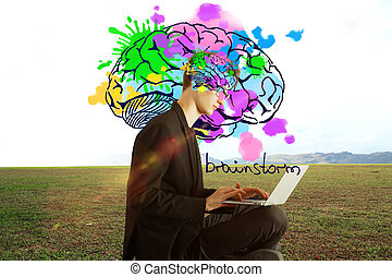 Creative mind concept - Side view of young businessman with...