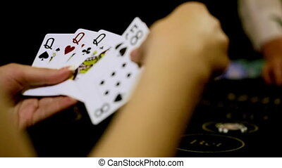 casino girl playing poker. close-up