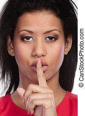 Secret woman. Girl showing hand silence sign