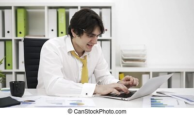 Anxious businessman typing