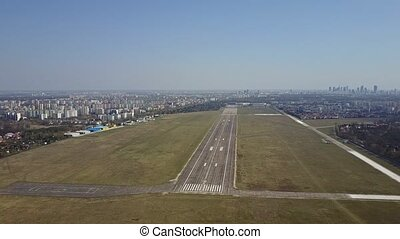 Propeller airplane taking off from airport runway on a sunny...