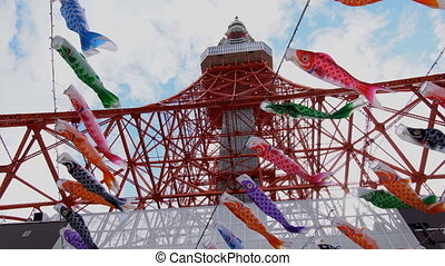 Tokyo tower and carp-shaped streamers - Tokyo, Japan-April...