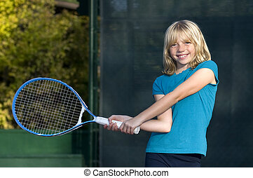 Young Tennis Player - Confident Elementary Age Girl on the...