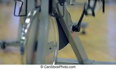 fitness: exercise bike spinning wheel and pedals.