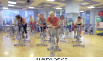 fitness: the people in the hall doing spin classes, soft focus background
