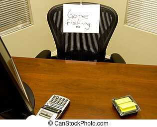 Gone Fishing! - Empty Desk with \'Gone Fishing\' Sign on...