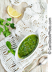 Mint parsley green sauce on wood background. toning....