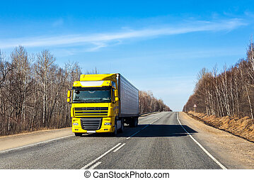 PRIMORYE, RUSSIA - APRIL 7, 2017: Truck on a road in early...