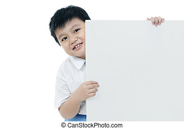 Cheerful boy holding blank card - Portrait of an elementary...