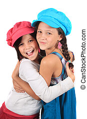 Sweet little sisters hug - Pretty young girls in the ages of...
