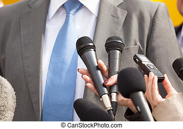 Press interview. News conference. - Media interview. Press...
