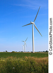 Wind Turbines against a Blue Sky in a Rural Setting