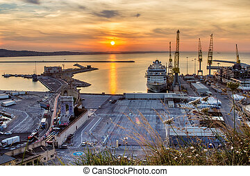 Industrial commercial port at sunset, Ancona, Italy
