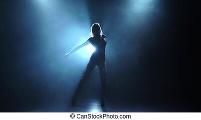 Slender female dancing in smoky studio, slow motion -...