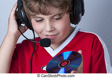 Gaming, Blonde boy with music helmet on his head and musical...