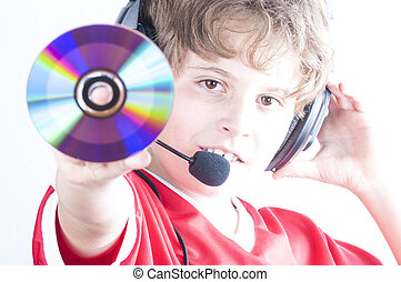 Blonde boy with music helmet on his head and musical records...