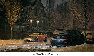 Cars Drive Through Suburbs In Snowfall - Cars drive through...