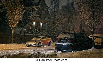 Cars Drive Through Suburbs In Snowfall - Cars drive through...