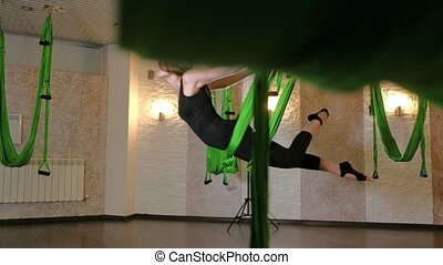 Practice of anti gravity fly yoga with hammock. 4K -...