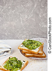 Toast with avocado, feta cheese, herbs and sesame seeds. Healthy eating and wholesome Breakfast