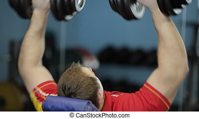 fitness: a man is at the gym.