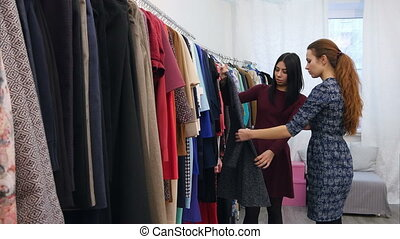 Young beautiful woman shopping in a boutique. Professional...