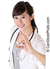 Attractive young medical doctor woman give ok gesture with...