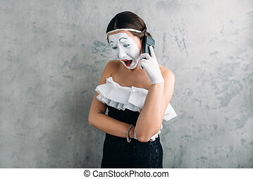 Mime actress performing with mobile phone. Comedy female...