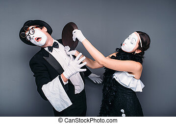 Pantomime theater performers with frying pan. Mime actors...