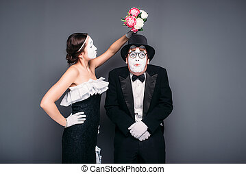 Comedy actor and actress poses with flower bouquet - Comedy...