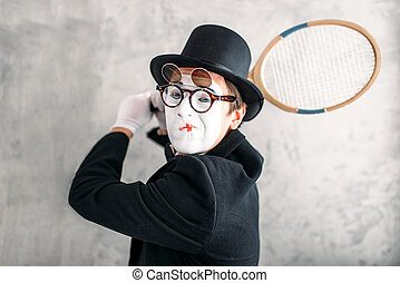 Pantomime actor performing with badminton racket. Comedy...