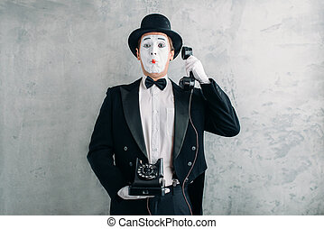 Pantomime actor performing with retro telephone - Pantomime...