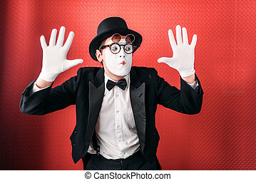 Male pantomime actor fun performing. Mime in suit, gloves,...