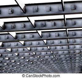 Iron Roof Girders - Pattern of gray steel girders in...