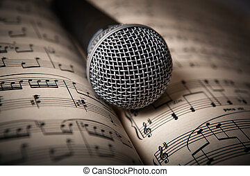 microphone lies on the music book close up