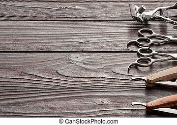 Vintage barber shop tools on wooden background - Vintage...