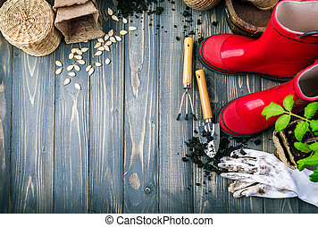 Gardening tools with soil red boots