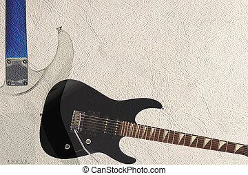 Black rock guitar and back of guitar body on light skin...