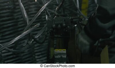 Man's hands connecting wire