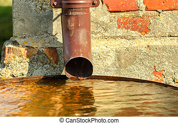 Drain pipe - Drain for rain water in a metal barrel