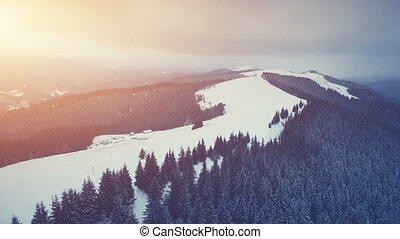Winter mountains, sunset time. Ski resort - Ski resort in...