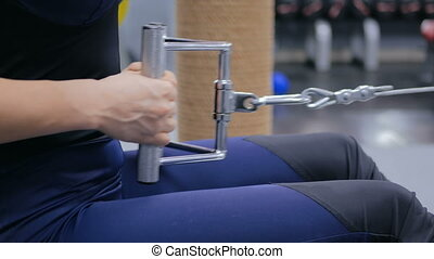 Close up shot. Athletic young woman working out on fitness...