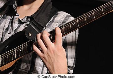 guitarist - The guitarist plays on a guitar shooting closeup